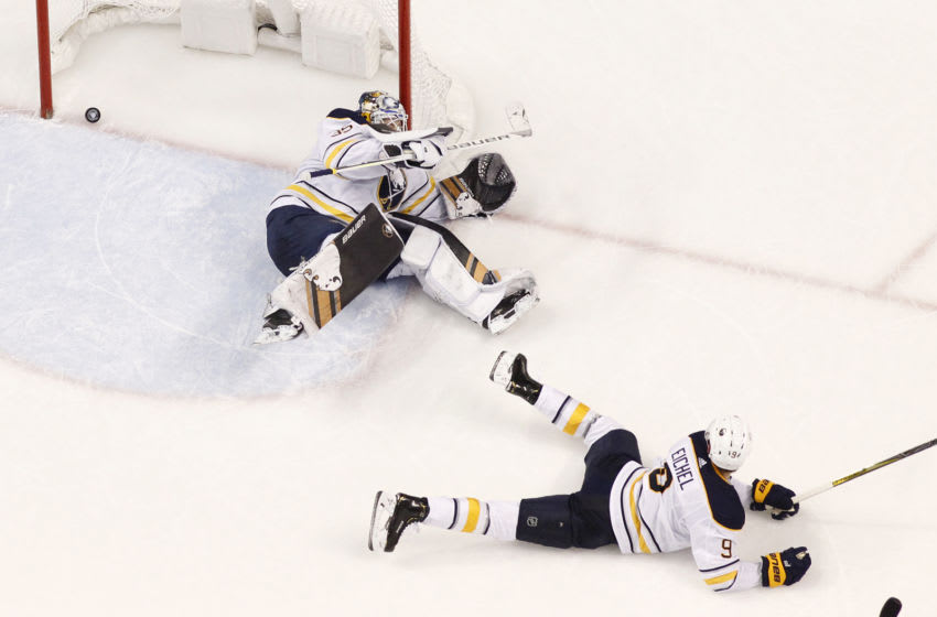SUNRISE, FL - NOVEMBER 30: Jack Eichel #9 of the Buffalo Sabres looks back at the net as the puck shot by Aleksander Barkov #16 of the Florida Panthers scores the winning goal in overtime past Goaltender Linus Ullmark #35at the BB&T Center on November 30, 2018 in Sunrise, Florida. The Panthers defeated the Sabres 3-2 in overtime. (Photo by Joel Auerbach/Getty Images)