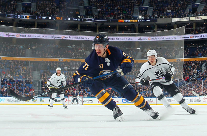 BUFFALO, NY - DECEMBER 11: Evan Rodrigues #71 of the Buffalo Sabres and Dustin Brown #23 of the Los Angeles Kings follow the play during an NHL game on December 11, 2018 at KeyBank Center in Buffalo, New York. Buffalo won, 4-3. (Photo by Bill Wippert/NHLI via Getty Images)