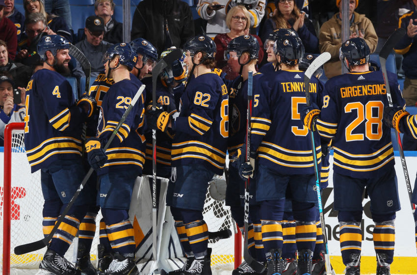 BUFFALO, NY - DECEMBER 13: The Buffalo Sabres celebrate a win after an NHL game against the Arizona Coyotes on December 13, 2018 at KeyBank Center in Buffalo, New York. Buffalo won, 3-1. (Photo by Bill Wippert/NHLI via Getty Images)