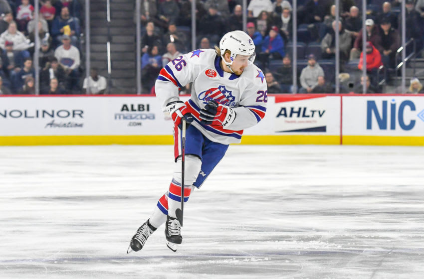 LAVAL, QC, CANADA - JANUARY 4: Rasmus Asplund #26 of the Rochester Americans skates up the ice against the Laval Rocket at Place Bell on January 4, 2019 in Laval, Quebec. (Photo by Stephane Dube /Getty Images)