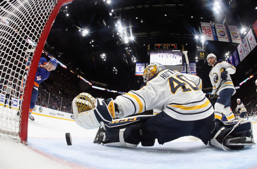 UNIONDALE, NEW YORK - MARCH 30: Anthony Beauvillier #18 of the New York Islanders scores at 6:07 of the third period against Carter Hutton #40 of the Buffalo Sabres at NYCB Live's Nassau Coliseum on March 30, 2019 in Uniondale, New York. The Islanders defeated the Sabres 5-1 to qualify for the playoffs. (Photo by Bruce Bennett/Getty Images)
