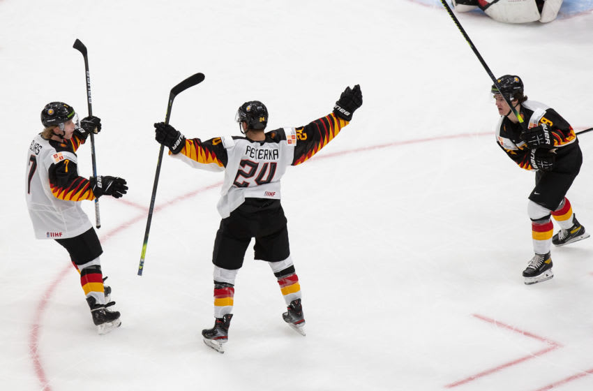 EDMONTON, AB - DECEMBER 26: Florian Elias #7, John Peterka #24 and Tim Stutzle #8 of Germany celebrate a goal against Canada during the 2021 IIHF World Junior Championship at Rogers Place on December 26, 2020 in Edmonton, Canada. (Photo by Codie McLachlan/Getty Images)