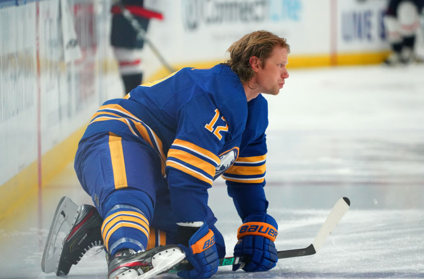 BUFFALO, NY - JANUARY 14: Eric Staal #12 of the Buffalo Sabres stretches in warms ups before the game \against the Washington Capitals at KeyBank Center on January 14 , 2021 in Buffalo, New York. (Photo by Kevin Hoffman/Getty Images)
