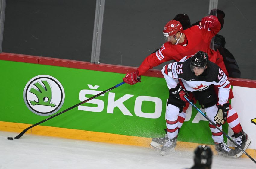 Russia's forward Yevgeni Timkin and Canada's defender Owen Power vie during the IIHF Men's Ice Hockey World Championships quarter final match between Russia and Canada, at the Olympic Sports Center in Riga, Latvia, on June 3, 2021. (Photo by Gints IVUSKANS / AFP) (Photo by GINTS IVUSKANS/AFP via Getty Images)