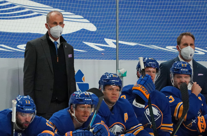 BUFFALO, NY - MARCH 18: Buffalo Sabres interim head coach Don Granato (left) and assistant coach Matt Ellis behind the bench during the game against the Boston Bruins at KeyBank Center on March 18, 2021 in Buffalo, New York. (Photo by Kevin Hoffman/Getty Images)