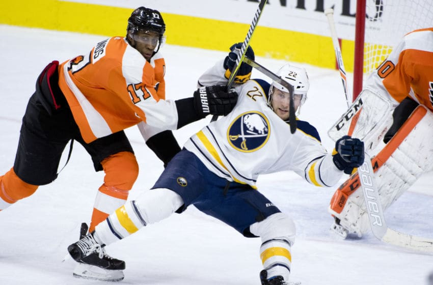 PHILADELPHIA, PA - JANUARY 07: Philadelphia Flyers Right Wing Wayne Simmonds (17) pushes Buffalo Sabres Left Wing Johan Larsson (22) away from the net in the second period during the game between the Buffalo Sabres and Philadelphia Flyers on January 07, 2018 at Wells Fargo Center in Philadelphia, PA. (Photo by Kyle Ross/Icon Sportswire via Getty Images)