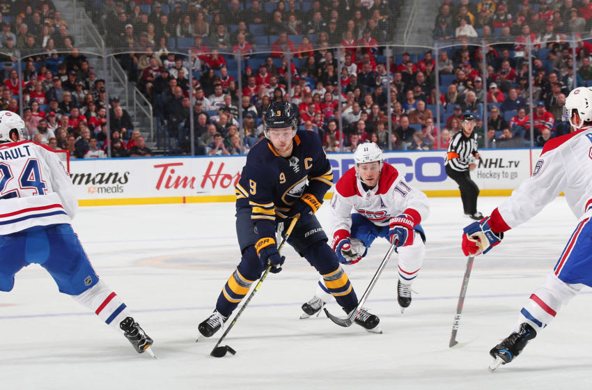 BUFFALO, NY - OCTOBER 25: Jack Eichel #9 of the Buffalo Sabres controls the puck against Brendan Gallagher #11 of the Montreal Canadiens during an NHL game on October 25, 2018 at KeyBank Center in Buffalo, New York. Buffalo won, 4-3. (Photo by Bill Wippert/NHLI via Getty Images)