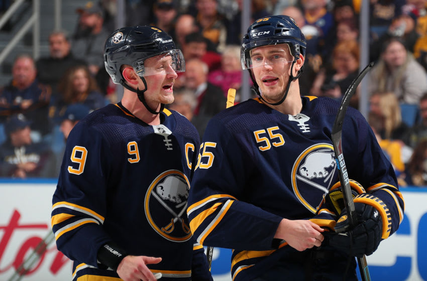 BUFFALO, NY - OCTOBER 14: Jack Eichel #9 and Rasmus Ristolainen #55 of the Buffalo Sabres talk strategy during a break in the action of an NHL game against the Dallas Stars on October 14, 2019 at KeyBank Center in Buffalo, New York. (Photo by Bill Wippert/NHLI via Getty Images)