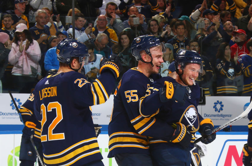 BUFFALO, NY - OCTOBER 22: Johan Larsson #22, Rasmus Ristolainen #55 and Jeff Skinner #53 of the Buffalo Sabres celebrates their overtime win against the San Jose Sharks during an NHL game on October 22, 2019 at KeyBank Center in Buffalo, New York. Buffalo won, 4-3. (Photo by Rob Marczynski/NHLI via Getty Images)