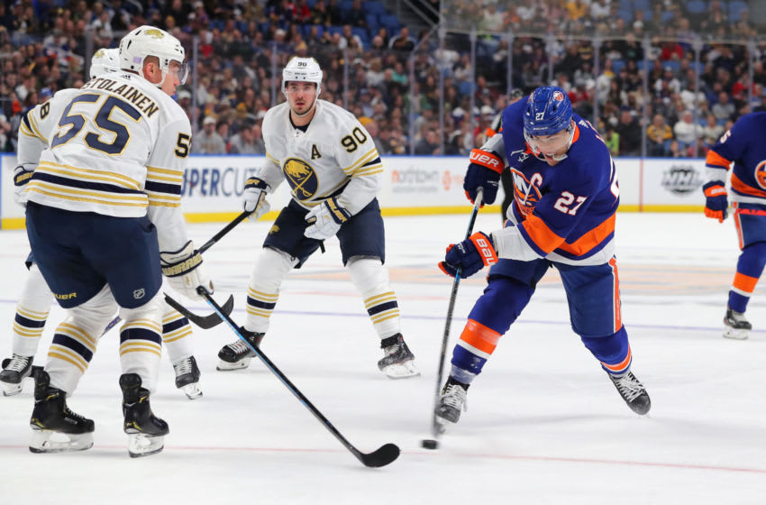 Nov 2, 2019; Buffalo, NY, USA; New York Islanders left wing Otto Koivula (21) shoots the puck as Buffalo Sabres defenseman Rasmus Ristolainen (55) defends during the first period at KeyBank Center. Mandatory Credit: Timothy T. Ludwig-USA TODAY Sports