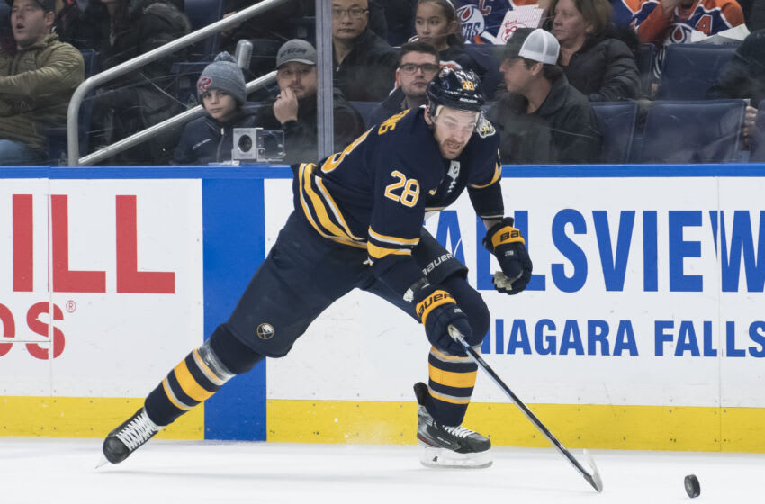 Jan 2, 2020; Buffalo, New York, USA; Buffalo Sabres center Zemgus Girgensons (28) chases the puck in the second period against the Edmonton Oilers at KeyBank Center. Mandatory Credit: Mark Konezny-USA TODAY Sports
