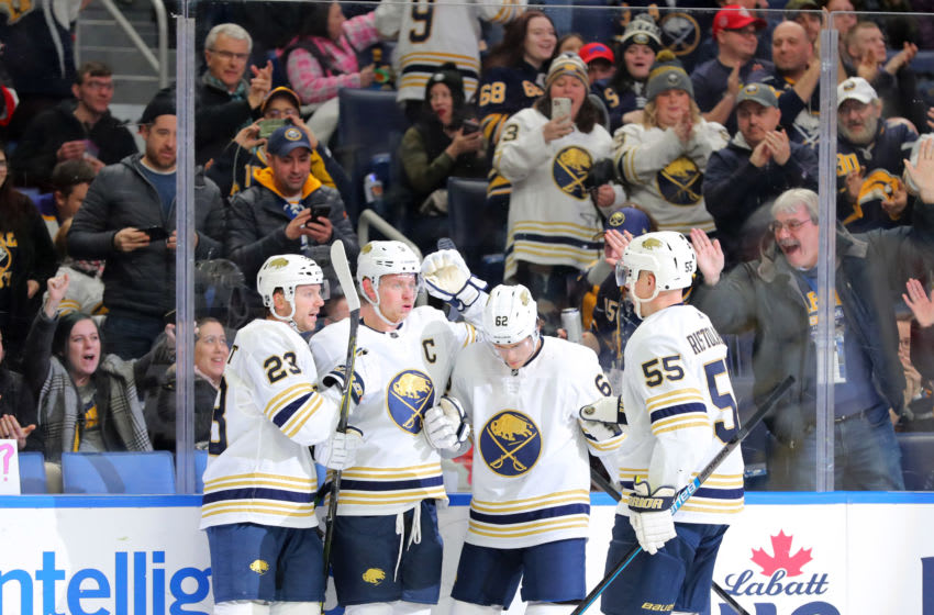 Feb 13, 2020; Buffalo, New York, USA; Buffalo Sabres center Jack Eichel (9) celebrates his goal with teammates during the second period against the Columbus Blue Jackets at KeyBank Center. Mandatory Credit: Timothy T. Ludwig-USA TODAY Sports