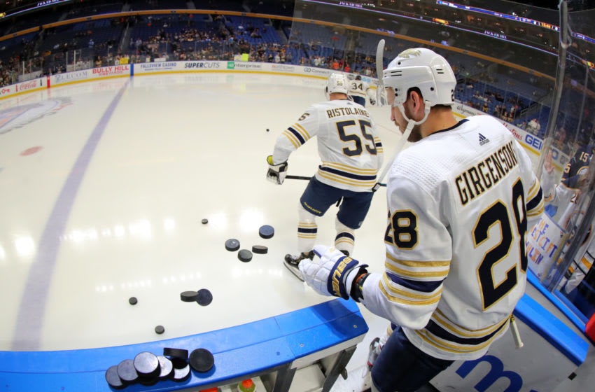 Mar 5, 2020; Buffalo, New York, USA; Buffalo Sabres center Zemgus Girgensons (28) knocks the pucks on the ice before a game against the Pittsburgh Penguins at KeyBank Center. Mandatory Credit: Timothy T. Ludwig-USA TODAY Sports