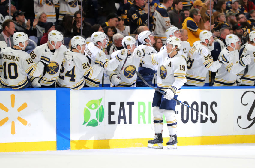 Mar 5, 2020; Buffalo, New York, USA; Buffalo Sabres defenseman Jake McCabe (19) celebrates his goal with teammates during the first period against the Pittsburgh Penguins at KeyBank Center. Mandatory Credit: Timothy T. Ludwig-USA TODAY Sports