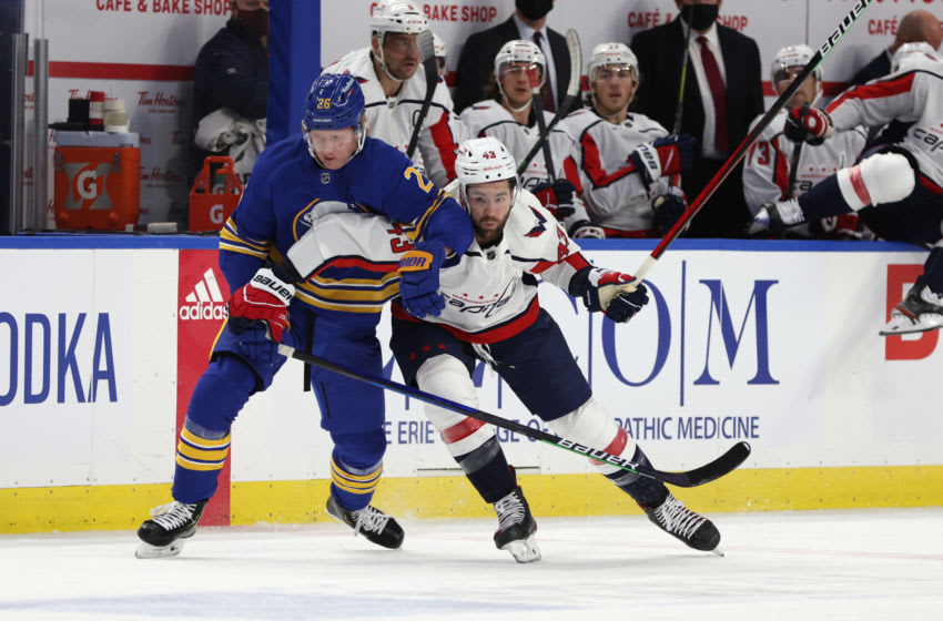 Jan 14, 2021; Buffalo, New York, USA; Buffalo Sabres defenseman Rasmus Dahlin (26) and Washington Capitals right wing Tom Wilson (43) go after a loose puck during the first period at KeyBank Center. Mandatory Credit: Timothy T. Ludwig-USA TODAY Sports