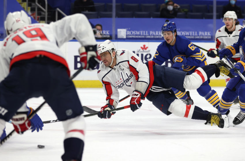 Jan 14, 2021; Buffalo, New York, USA; Washington Capitals left wing Alex Ovechkin (8) takes a shot on goal during the first period against the Buffalo Sabres at KeyBank Center. Mandatory Credit: Timothy T. Ludwig-USA TODAY Sports