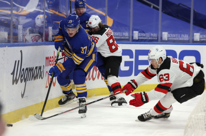 Jan 31, 2021; Buffalo, New York, USA; Buffalo Sabres forward Casey Mittelstadt (37) and New Jersey Devils left wing Jesper Bratt (63) go after a loose puck during the third period at KeyBank Center. Mandatory Credit: Timothy T. Ludwig-USA TODAY Sports