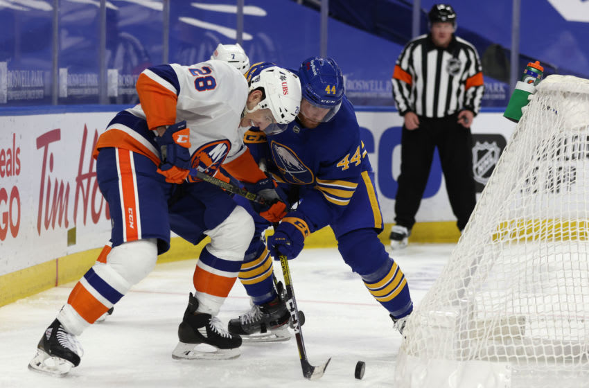 Feb 15, 2021; Buffalo, New York, USA; New York Islanders left wing Michael Dal Colle (28) and Buffalo Sabres defenseman Matthew Irwin (44) go after a loose puck behind the net during the third period at KeyBank Center. Mandatory Credit: Timothy T. Ludwig-USA TODAY Sports