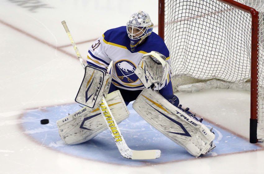 Mar 24, 2021; Pittsburgh, Pennsylvania, USA; Buffalo Sabres goaltender Dustin Tokarski (31) warms up before playing the Pittsburgh Penguins at PPG Paints Arena. Mandatory Credit: Charles LeClaire-USA TODAY Sports