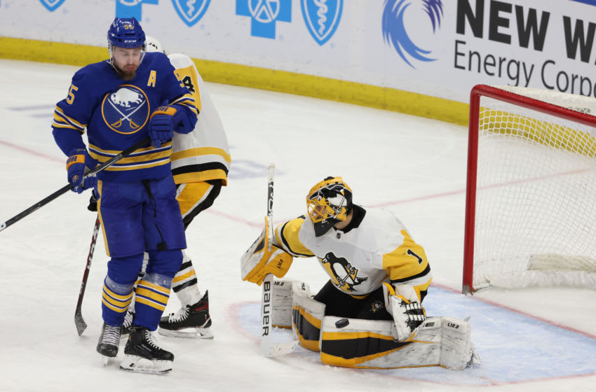 Apr 18, 2021; Buffalo, New York, USA; Pittsburgh Penguins goaltender Casey DeSmith (1) makes a save as Buffalo Sabres defenseman Rasmus Ristolainen (55) looks on during the third period at KeyBank Center. Mandatory Credit: Timothy T. Ludwig-USA TODAY Sports