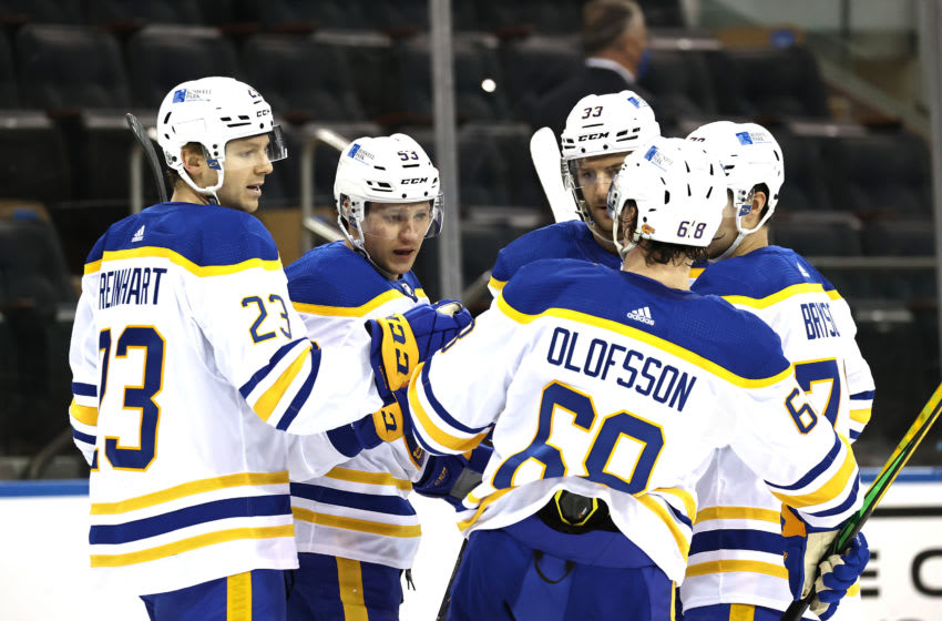 Apr 25, 2021; New York, New York, USA; Jeff Skinner #53 of the Buffalo Sabres is congratulated by teammates Sam Reinhart #23,Victor Olofsson #68 and Colin Miller #33 after he scored in the first period against the New York Rangers at Madison Square Garden on April 25, 2021 in New York City. Mandatory Credit: Elsa/Pool Photo-USA TODAY Sports