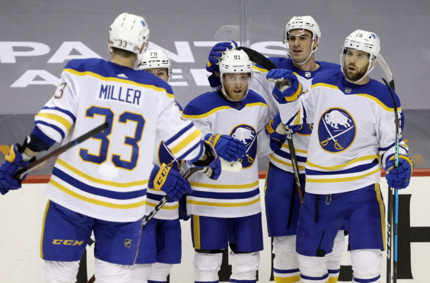 May 6, 2021; Pittsburgh, Pennsylvania, USA; Buffalo Sabres teammates congratulate center Drake Caggiula (91) on his second goal of the game against the Pittsburgh Penguins during the second period at PPG Paints Arena. Mandatory Credit: Charles LeClaire-USA TODAY Sports