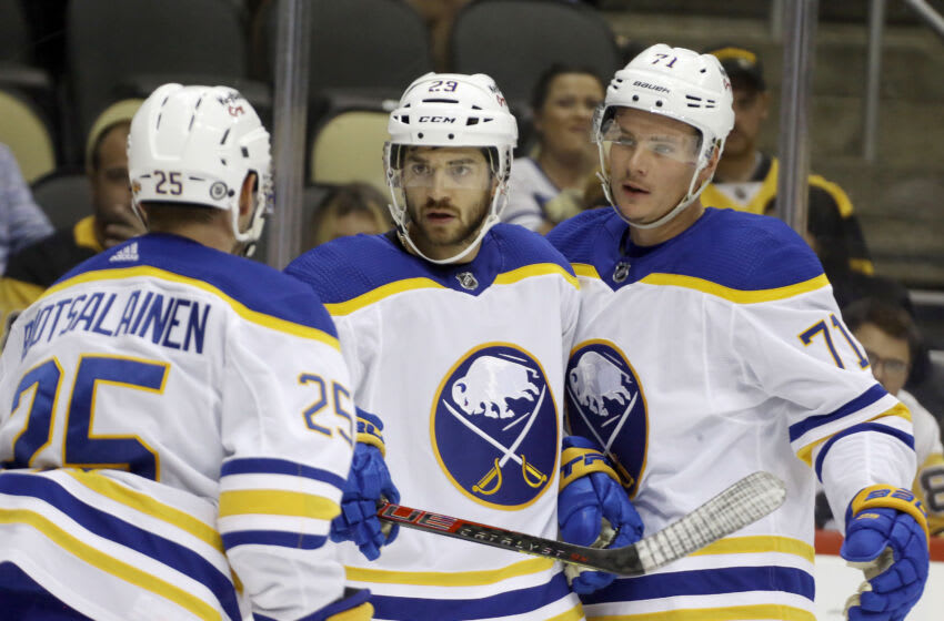Oct 5, 2021; Pittsburgh, Pennsylvania, USA; Buffalo Sabres left wing Vinnie Hinostroza (29) celebrates with center Arttu Ruotsalainen (25) and right wing Victor Olofsson (71) after scoring a goal against the Pittsburgh Penguins during the first period at PPG Paints Arena. Mandatory Credit: Charles LeClaire-USA TODAY Sports