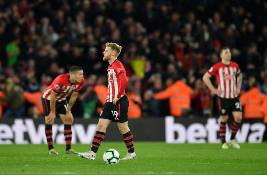 SOUTHAMPTON, ENGLAND - APRIL 05: Josh Sims of Southampton and his team mates look dejected following their side's defeat in the Premier League match between Southampton FC and Liverpool FC at St Mary's Stadium on April 05, 2019 in Southampton, United Kingdom. (Photo by Dan Mullan/Getty Images)