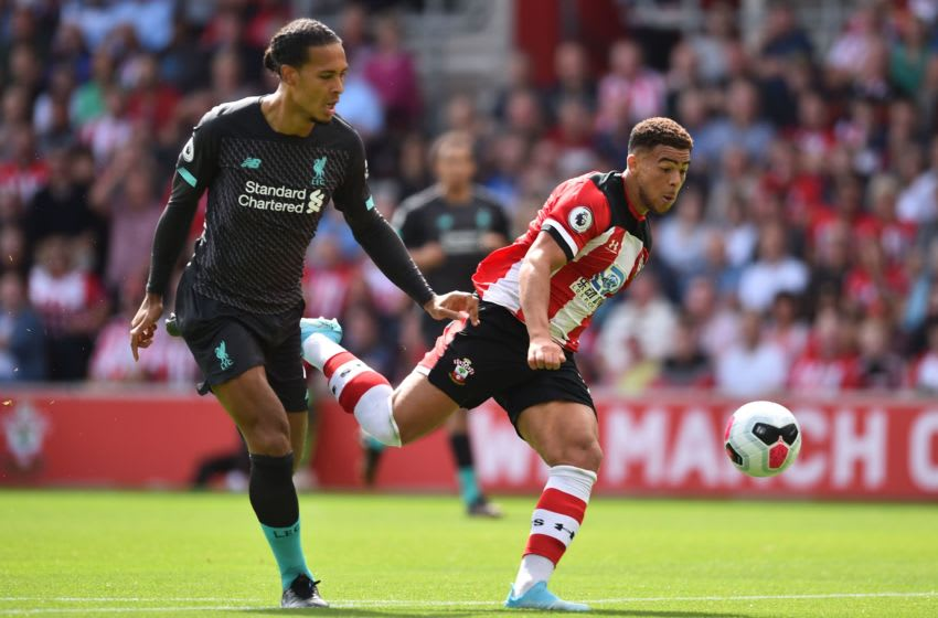 Southampton's English midfielder Che Adams (R) vies with Liverpool's Dutch defender Virgil van Dijk (L) during the English Premier League football match between Southampton and Liverpool at St Mary's Stadium in Southampton, southern England on August 17, 2019. (Photo by Glyn KIRK / AFP) / RESTRICTED TO EDITORIAL USE. No use with unauthorized audio, video, data, fixture lists, club/league logos or 'live' services. Online in-match use limited to 120 images. An additional 40 images may be used in extra time. No video emulation. Social media in-match use limited to 120 images. An additional 40 images may be used in extra time. No use in betting publications, games or single club/league/player publications. / (Photo credit should read GLYN KIRK/AFP via Getty Images)
