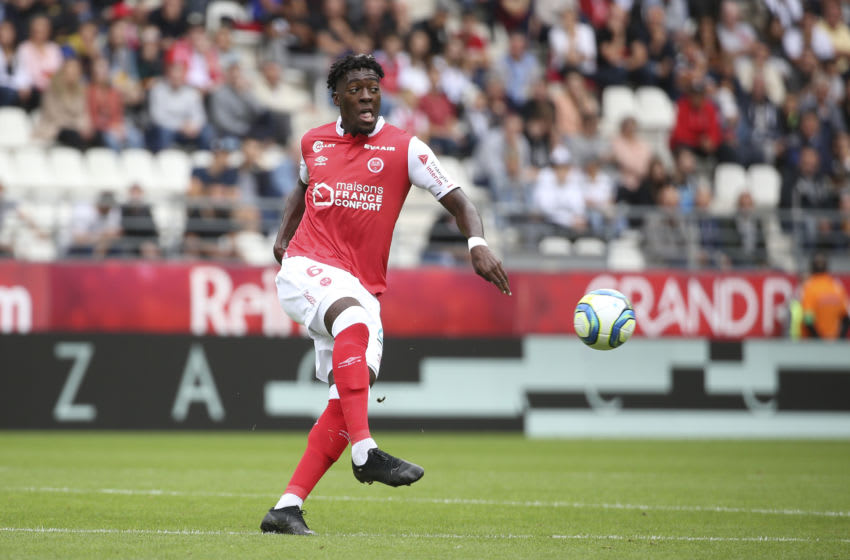 REIMS, FRANCE - AUGUST 18: Axel Disasi of Reims during the French Ligue 1 match between Stade de Reims and RC Strasbourg at Stade Auguste Delaune on August 18, 2019 in Reims, France. (Photo by Jean Catuffe/Getty Images)