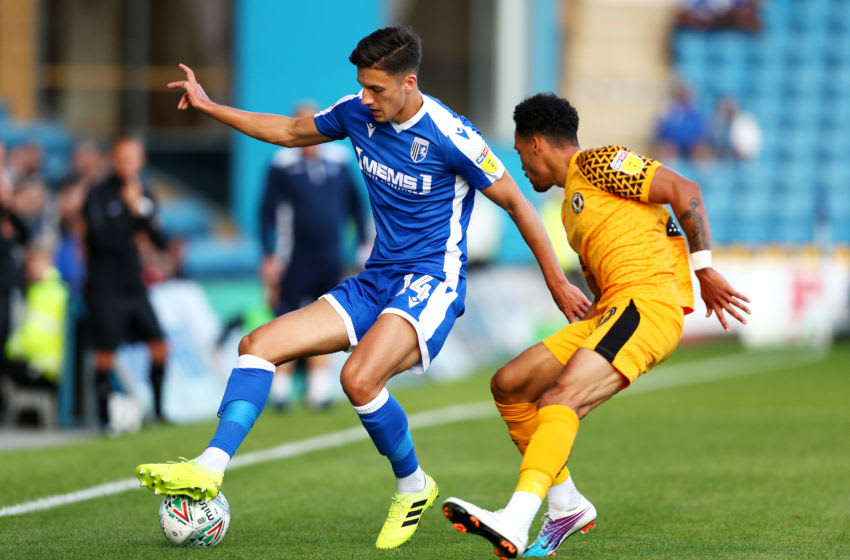 GILLINGHAM, ENGLAND - AUGUST 13: Alfie Jones of Gillingham FC is challenged by Corey Whitely of Newport County during the Carabao Cup First Round match between Gillingham and Newport County at MEMS Priestfield Stadium on August 13, 2019 in Gillingham, England. (Photo by Jack Thomas/Getty Images)