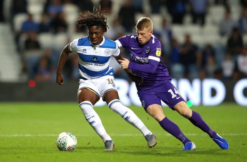 LONDON, ENGLAND - AUGUST 28: Eberechi Eze of Queens Park Rangers battles for possession with Andy Cannon of Portsmouth during the Carabao Cup Second Round match between Queens Park Rangers at Loftus Road on August 28, 2019 in London, England. (Photo by Alex Pantling/Getty Images)