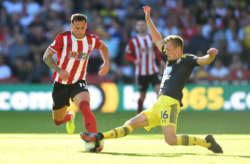 SHEFFIELD, ENGLAND - SEPTEMBER 14: Billy Sharp of Sheffield United is challenged by James Ward-Prowse of Southampton during the Premier League match between Sheffield United and Southampton FC at Bramall Lane on September 14, 2019 in Sheffield, United Kingdom. (Photo by Nathan Stirk/Getty Images)