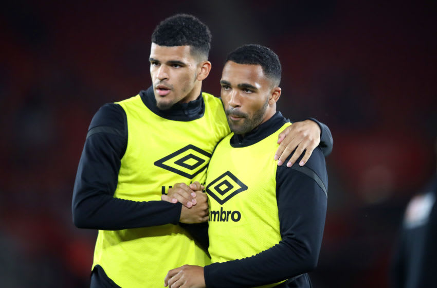 SOUTHAMPTON, ENGLAND - SEPTEMBER 20: Dominic Solanke and Callum Wilson of AFC Bournemouth speak as they warm up prior to the Premier League match between Southampton FC and AFC Bournemouth at St Mary's Stadium on September 20, 2019 in Southampton, United Kingdom. (Photo by Alex Pantling/Getty Images)
