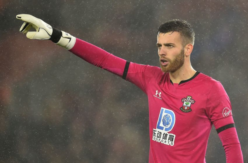 Southampton's English goalkeeper Angus Gunn gestures during the English Premier League football match between Southampton and Leicester City at St Mary's Stadium in Southampton, southern England on October 25, 2019. (Photo by Glyn KIRK / AFP) / RESTRICTED TO EDITORIAL USE. No use with unauthorized audio, video, data, fixture lists, club/league logos or 'live' services. Online in-match use limited to 120 images. An additional 40 images may be used in extra time. No video emulation. Social media in-match use limited to 120 images. An additional 40 images may be used in extra time. No use in betting publications, games or single club/league/player publications. / (Photo by GLYN KIRK/AFP via Getty Images)