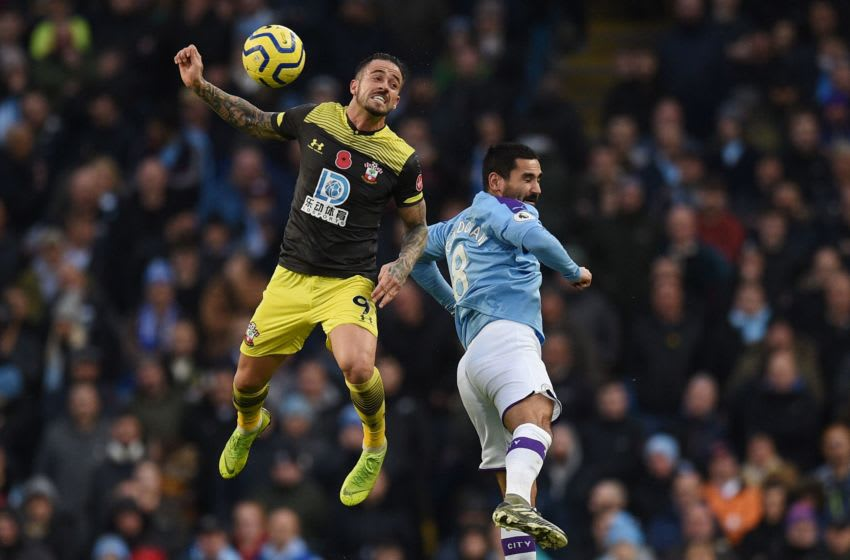 TOPSHOT - Southampton's English striker Danny Ings (L) jumps against Manchester City's German midfielder Ilkay Gundogan (R) during the English Premier League football match between Manchester City and Southampton at the Etihad Stadium in Manchester, north west England, on November 2, 2019. (Photo by Oli SCARFF / AFP) / RESTRICTED TO EDITORIAL USE. No use with unauthorized audio, video, data, fixture lists, club/league logos or 'live' services. Online in-match use limited to 120 images. An additional 40 images may be used in extra time. No video emulation. Social media in-match use limited to 120 images. An additional 40 images may be used in extra time. No use in betting publications, games or single club/league/player publications. / (Photo by OLI SCARFF/AFP via Getty Images)