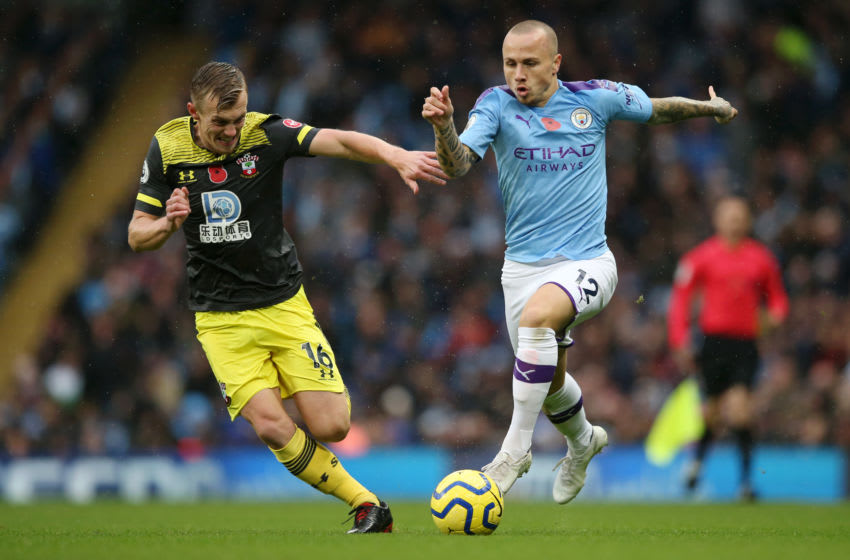 MANCHESTER, ENGLAND - NOVEMBER 02: Angelino of Manchester City battles for possession with James Ward-Prowse of Southampton during the Premier League match between Manchester City and Southampton FC at Etihad Stadium on November 02, 2019 in Manchester, United Kingdom. (Photo by Jan Kruger/Getty Images)