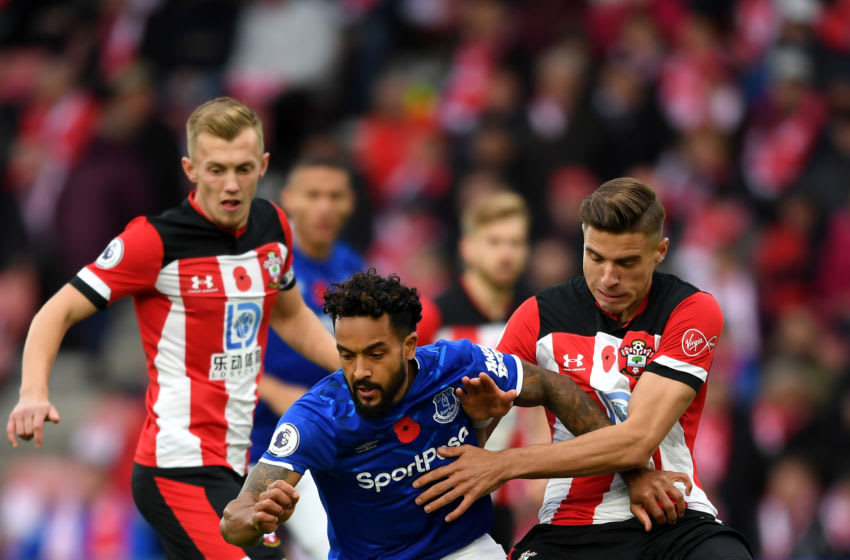 SOUTHAMPTON, ENGLAND - NOVEMBER 09: Theo Walcott of Everton battles for possession with Jan Bednarek of Southampton during the Premier League match between Southampton FC and Everton FC at St Mary's Stadium on November 09, 2019 in Southampton, United Kingdom. (Photo by Alex Davidson/Getty Images)