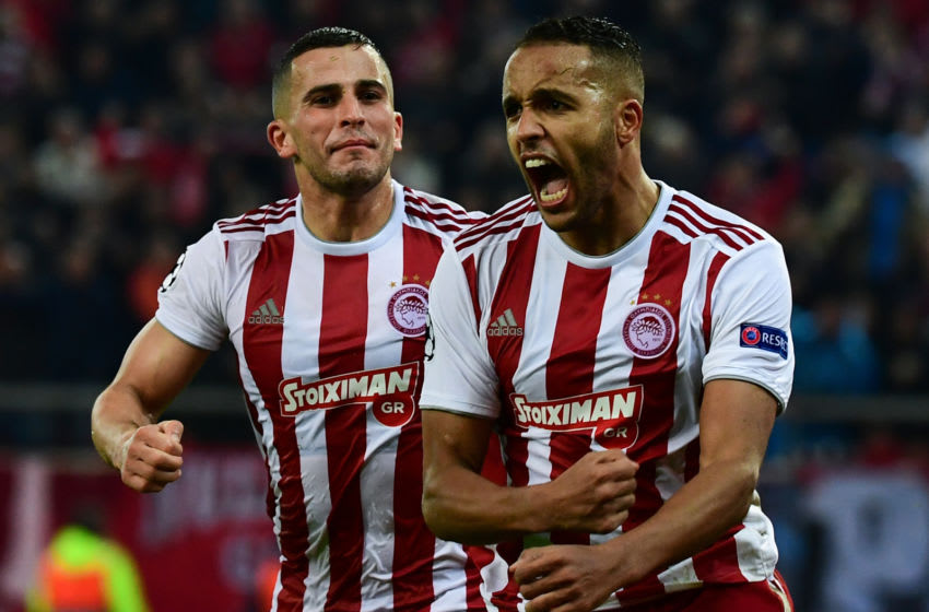 Olympiakos' Moroccan forward Youssef El-Arabi (R) celebrates scoring a penalty with Olympiakos' Norwegian defender Omar Elabdellaoui during UEFA Champions League during the Group B football match between Olympiacos FC and FK Crvena zvezda (Red Star Belgrade) at the Karaiskakis Stadium in Piraeus, near Athens, on December 11, 2019. (Photo by ARIS MESSINIS / AFP) (Photo by ARIS MESSINIS/AFP via Getty Images)