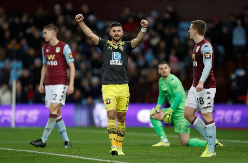 Southampton's Irish striker Shane Long celebrates as Southampton's English striker Danny Ings scores his team's third goal during the English Premier League football match between Aston Villa and Southampton at Villa Park in Birmingham, central England on December 18, 2019. (Photo by Adrian DENNIS / AFP) / RESTRICTED TO EDITORIAL USE. No use with unauthorized audio, video, data, fixture lists, club/league logos or 'live' services. Online in-match use limited to 120 images. An additional 40 images may be used in extra time. No video emulation. Social media in-match use limited to 120 images. An additional 40 images may be used in extra time. No use in betting publications, games or single club/league/player publications. / (Photo by ADRIAN DENNIS/AFP via Getty Images)