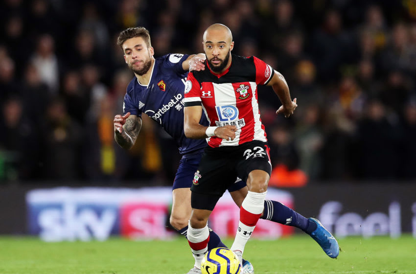 SOUTHAMPTON, ENGLAND - NOVEMBER 30: Nathan Redmond of Southampton runs with the ball under pressure from Kiko Femenia of Watford during the Premier League match between Southampton FC and Watford FC at St Mary's Stadium on November 30, 2019 in Southampton, United Kingdom. (Photo by Naomi Baker/Getty Images)