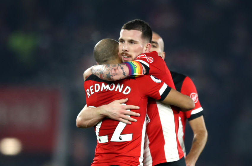 SOUTHAMPTON, ENGLAND - DECEMBER 04: Pierre-Emile Hojbjerg of Southampton celebrates with teammate Nathan Redmond at full-time after the Premier League match between Southampton FC and Norwich City at St Mary's Stadium on December 04, 2019 in Southampton, United Kingdom. (Photo by Bryn Lennon/Getty Images)