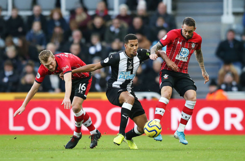 NEWCASTLE UPON TYNE, ENGLAND - DECEMBER 08: Isaac Hayden of Newcastle United battles for possession with James Ward-Prowse and Danny Ings of Southampton during the Premier League match between Newcastle United and Southampton FC at St. James Park on December 08, 2019 in Newcastle upon Tyne, United Kingdom. (Photo by Jan Kruger/Getty Images)