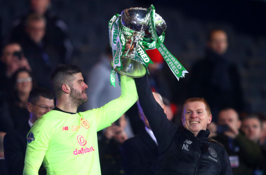 GLASGOW, SCOTLAND - DECEMBER 08: Fraser Forster of Celtic lifts the Betfred Cup with Neil Lennon, Manager of Celtic after the Betfred Cup Final between Rangers FC and Celtic FC at Hampden Park on December 08, 2019 in Glasgow, Scotland. (Photo by Michael Steele/Getty Images)