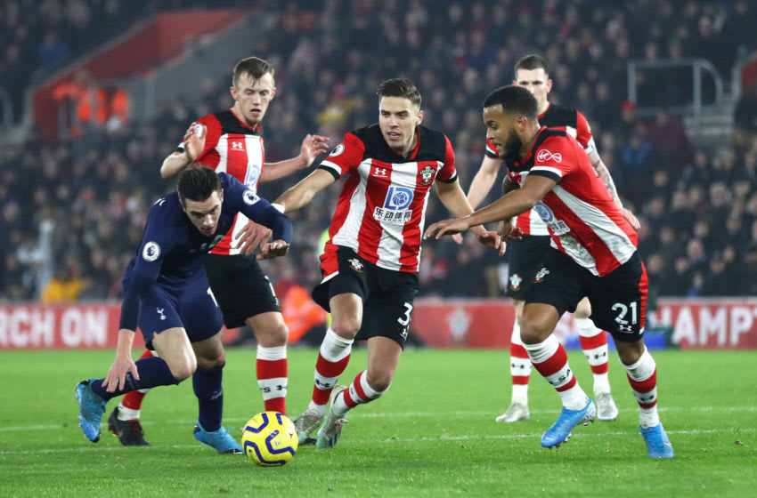 SOUTHAMPTON, ENGLAND - JANUARY 01: Giovani Lo Celso of Tottenham Hotspur battles for possession with James Ward-Prowse, Jan Bednarek and Ryan Bertrand of Southampton during the Premier League match between Southampton FC and Tottenham Hotspur at St Mary's Stadium on January 01, 2020 in Southampton, United Kingdom. (Photo by Michael Steele/Getty Images)