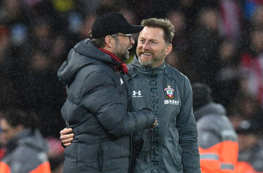 Liverpool's German manager Jurgen Klopp (L) and Southampton's Austrian manager Ralph Hasenhuttl react after the fuibnak whistle during the English Premier League football match between Liverpool and Southampton at Anfield in Liverpool, north west England on February 1, 2020. (Photo by Paul ELLIS / AFP) / RESTRICTED TO EDITORIAL USE. No use with unauthorized audio, video, data, fixture lists, club/league logos or 'live' services. Online in-match use limited to 120 images. An additional 40 images may be used in extra time. No video emulation. Social media in-match use limited to 120 images. An additional 40 images may be used in extra time. No use in betting publications, games or single club/league/player publications. / (Photo by PAUL ELLIS/AFP via Getty Images)