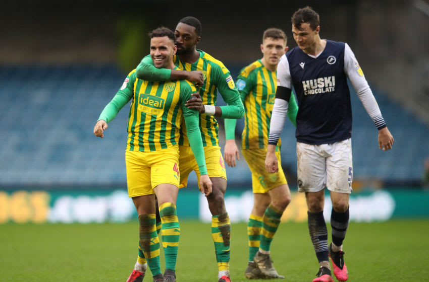 LONDON, ENGLAND - FEBRUARY 09: Hal Robson-Kanu of West Bromwich Albion shares a laugh with Semi Ajayi after clashing with Jake Cooper of Millwall during the Sky Bet Championship match between Millwall and West Bromwich Albion at The Den on February 09, 2020 in London, England. (Photo by Alex Pantling/Getty Images)