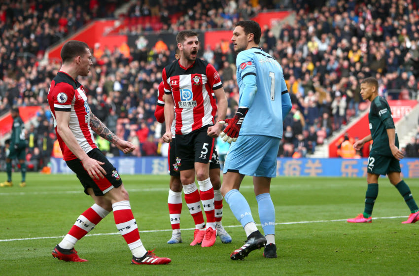 SOUTHAMPTON, ENGLAND - MARCH 07: Jack Stephens and Alex McCarthy of Southampton celebrate after Alex McCarthy of Southampton saved a penalty shot from Matt Ritchie of Newcastle United (not pictured) during the Premier League match between Southampton FC and Newcastle United at St Mary's Stadium on March 07, 2020 in Southampton, United Kingdom. (Photo by Charlie Crowhurst/Getty Images)