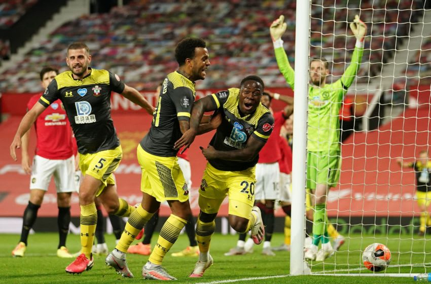 Southampton's Irish-born striker Michael Obafemi (C) turns to celebrate after scoring their late second goal during the English Premier League football match between Manchester United and Southampton at Old Trafford in Manchester, north-west England, on July 13, 2020. - The game finished 2-2. (Photo by Dave Thompson / POOL / AFP) / RESTRICTED TO EDITORIAL USE. No use with unauthorized audio, video, data, fixture lists, club/league logos or 'live' services. Online in-match use limited to 120 images. An additional 40 images may be used in extra time. No video emulation. Social media in-match use limited to 120 images. An additional 40 images may be used in extra time. No use in betting publications, games or single club/league/player publications. / (Photo by DAVE THOMPSON/POOL/AFP via Getty Images)