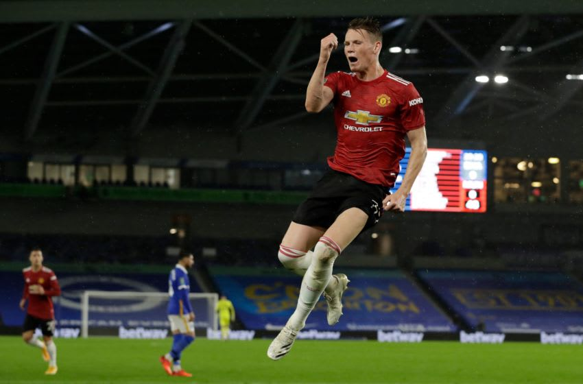 Manchester United's Scottish midfielder Scott McTominay celebrates after he scores his team's first goal during the English League Cup fourth round football match between Brighton and Hove Albion and Manchester United at the American Express Community Stadium in Brighton, southern England on September 30, 2020. (Photo by Matt Dunham / POOL / AFP) / RESTRICTED TO EDITORIAL USE. No use with unauthorized audio, video, data, fixture lists, club/league logos or 'live' services. Online in-match use limited to 120 images. An additional 40 images may be used in extra time. No video emulation. Social media in-match use limited to 120 images. An additional 40 images may be used in extra time. No use in betting publications, games or single club/league/player publications. / (Photo by MATT DUNHAM/POOL/AFP via Getty Images)